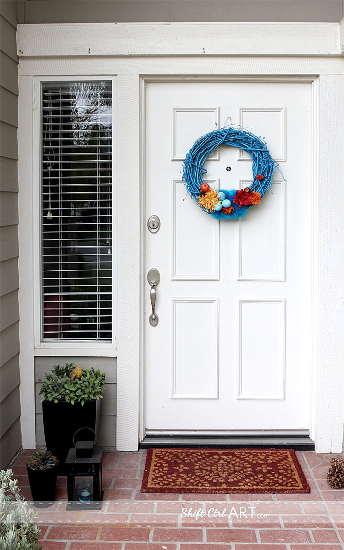 Pin It & Egg and feather goes together - jewel toned Easter door wreath