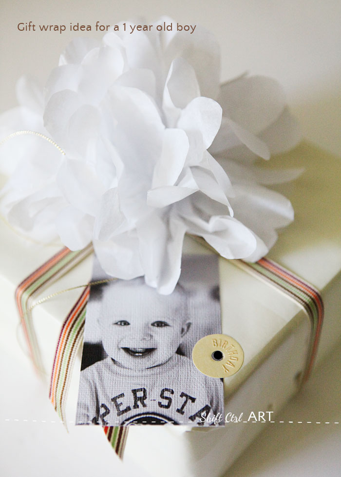 #Gift #wrap idea for a one year old. #DIY gift topper and photo tag