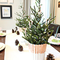 Miniature Christmas trees with garland and copper crackle finished pots