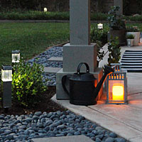Make a lantern LED and use solar in the back-yard.