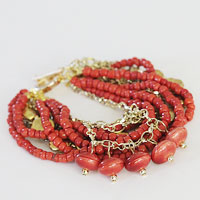 Make a chunky bracelet  with beads and chains.