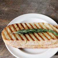 Fresh rosemary-paprika-Munster-cheese-panini