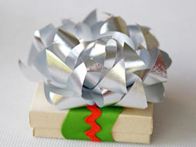 Transform cheap gift bows into beautiful flowers toppers