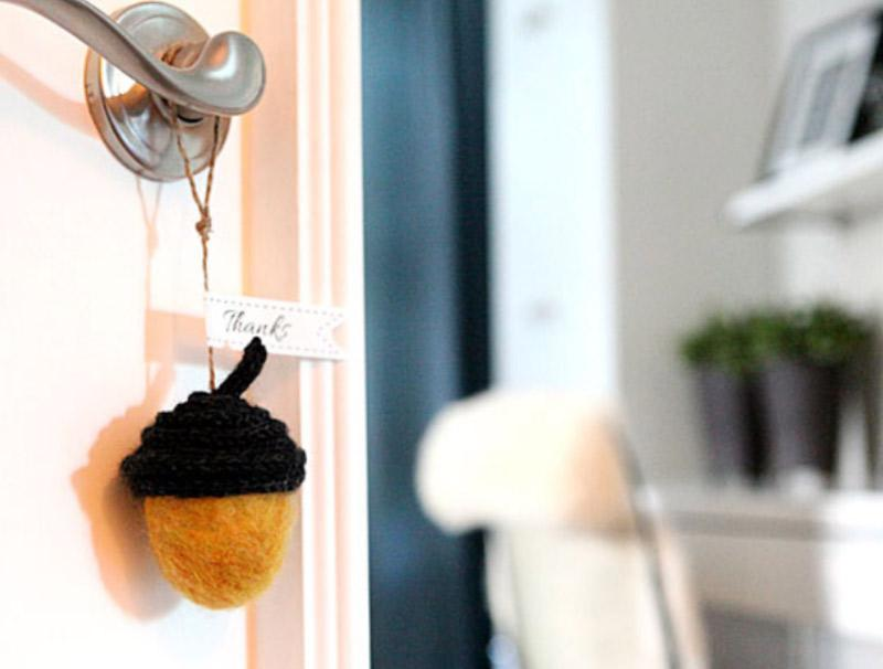 Felted acorn - a door hanger