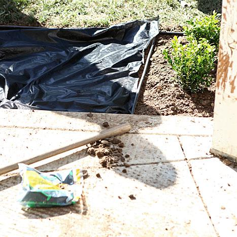 Our Patio progress: paint, sprinklers, flower bed, and new concrete - the work